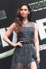 Megan Fox added edge to her sexy dress with a black leather belt during the 'Teenage Mutant Ninja Turtles' press conference in Seoul.