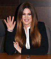 Khloe Kardashian wore her long, ultra shiny hair sleek and straight at a signing for her new book 'Dollhouse.'