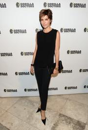 Lisa Rinna opted for all black - even down to her classic leather clutch.