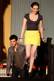 Kristen Stewart paired her lemon yellow skirt with a tight brown t-shirt at a Q & A session for 'The Twilight Saga: Eclipse.'