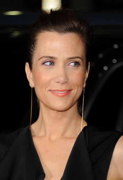 Kristen Wiig Gold Dangle Earrings [hair,face,eyebrow,hairstyle,lip,chin,forehead,beauty,cheek,head,arrivals,kristen wiig,paul,grauman,california,hollywood,chinese theater,universal pictures,premiere,premiere]