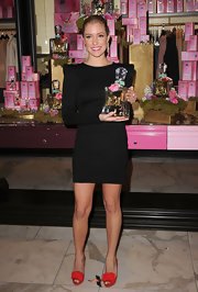 Kristin Cavallari added a playful pop to her bold shouldered black dress with red peep toes. Girlie toe embellishments complete the adorable look.