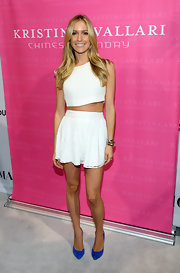 Kristin stuck to a crisp and clean look with a white mini skirt paired with a stark white matching crop top.