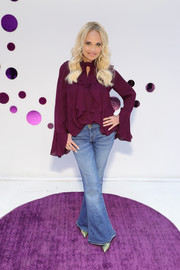 Kristin Chenoweth attended the Rhofade cream launch wearing a loose purple ruffle blouse.