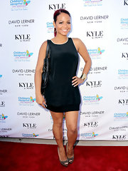 Christina Milian wore a sleeveless black dress to a fundraiser for the children's hospital.