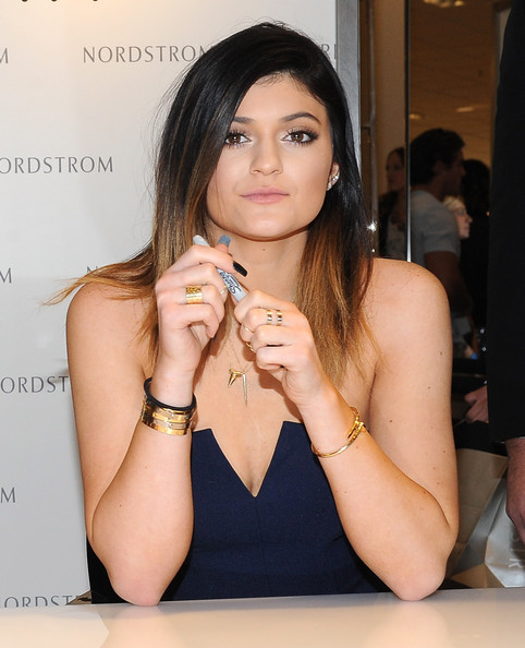 Kylie Jenner Wide Band Ring [hair,beauty,lady,skin,hairstyle,long hair,lip,black hair,finger,fashion accessory,kylie jenner launch their new shoe and handbag collection kendall kylie for madden,kendall jenner,kylie jenner,girl collection,the americana at brand,california,glendale,nordstrom,photocall]