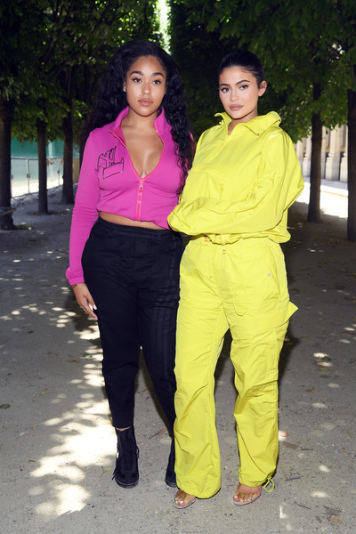 Kylie Jenner Half-Zip Sweater [clothing,yellow,pink,outerwear,fun,trousers,jeans,waist,abdomen,kylie jenner,jordyn woods,front row,spring,summer 2019,paris,louis vuitton,menswear spring,paris fashion week,show]