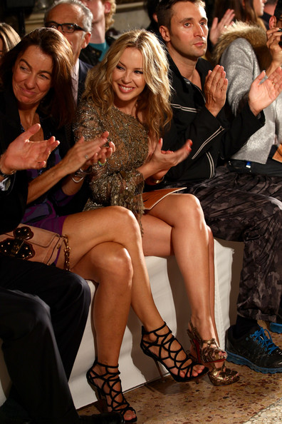 Kylie Minogue Strappy Sandals [fashion,leg,thigh,event,dress,human leg,human body,fun,sitting,long hair,emilio pucci,laudomia pucci,francesco vezzoli,kylie minogue,backstage - front row,s/,milan,emilio pucci spring,milan fashion week,fashion show]