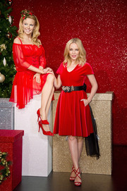 Kylie Minogue looked festive in a red velvet fit-and-flare dress by Emilio de la Morena while visiting Madame Tussauds.