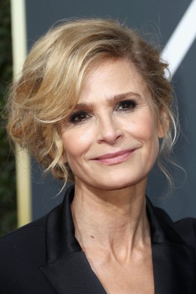 Kyra Sedgwick Messy Updo [hair,face,hairstyle,blond,eyebrow,chin,lip,layered hair,forehead,long hair,arrivals,kyra sedgwick,beverly hills,california,the beverly hilton hotel,golden globe awards,the 75th annual golden globe awards]