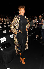 Melanie paired her leopard print coat with a caramel pair of ankle boots.
