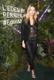 Martha Hunt tempered a racy lace top with a fitted black blazer when she attended the L'Eden by Perrier-Jouet closing night event.