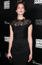 Mandy Moore accented her glam lace dress with a sleek black star-studded box clutch.