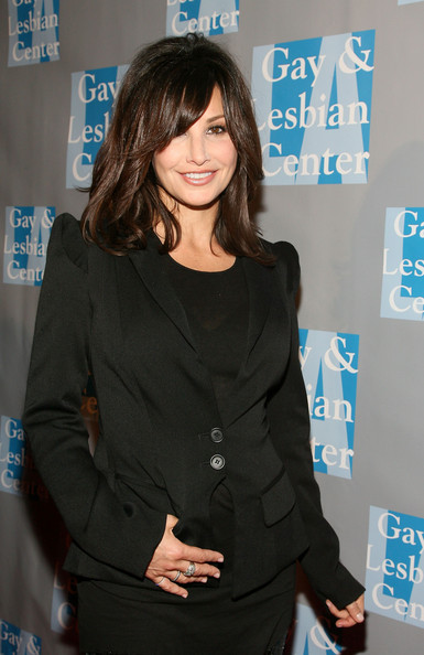 More Pics of Gina Gershon Medium Layered Cut (1 of 4) - Medium Layered Cut Lookbook - StyleBistro [an evening with women,hairstyle,outerwear,white-collar worker,long hair,premiere,suit,black hair,blazer,arrivals,gina gershon,beverly hills,california,l.a. gay lesbian center]