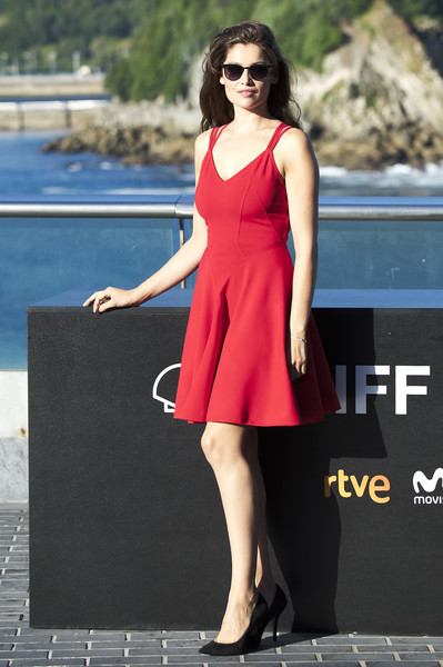 Laetitia Casta chose a red skater dress with strappy shoulders for the San Sebastian Film Festival photocall for 'A Faithful Man.'
