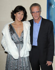 Sophie Marceau softened up her too-touch ankle boots and twirl-worthy dress with a cozy fur coat.