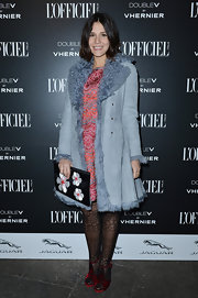 Margherita Missoni donned a pair of vintage-looking red velvet sandals with a fur-trimmed coat and a cocktail dress for the L'Officiel dinner.