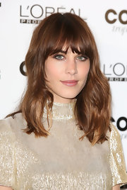Alexa Chung showed off her rich auburn with this naturally wavy 'do with blunt bangs.
