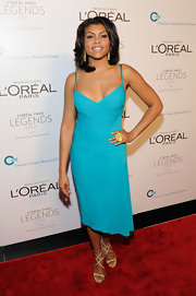 Taraji P. Henson wore a vibrant turquoise spaghetti strap dress for the Ovarian Cancer Research benefit.