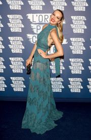 Petra Nemcova flashed some skin in a green Zuhair Murad halter gown with see-through lace panels during the L'Oreal Paris Blue Obsession party.