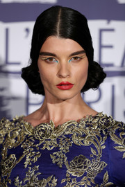 Crystal Renn added more drama with winged gold and blue eyeshadow.
