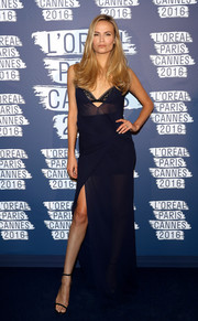 Natasha Poly was her usual seductive self in a sheer navy gown during the L'Oreal Paris Blue Obsession party.