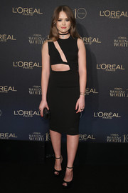 Kristina Bazan complemented her LBD with classic black ankle-strap peep-toes.