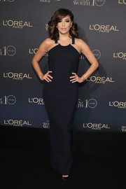 Eva Longoria looked ageless in a figure-skimming black halter gown by Amanda Wakeley at the L'Oreal Paris Women of Worth celebration.