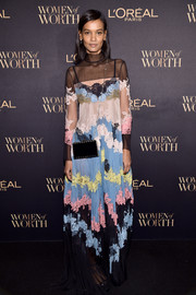 A black box bag with a gold chain strap finished off Liya Kebede's look.