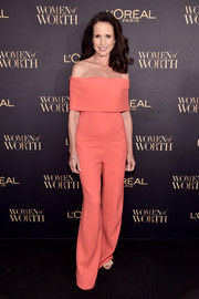 Andie MacDowell chose a sleek, sophisticated coral off-the-shoulder jumpsuit by Lela Rose for the L'Oreal Paris Women of Worth celebration.