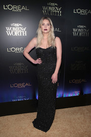 Ashley Benson cut a sultry figure in an embellished black slip gown by Moschino at the L'Oreal Women of Worth celebration.