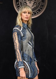 Karolina Kurkova hit the L'Oreal x Balmain party rocking an ornately detailed mini dress.