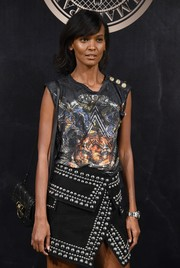 Liya Kebede was edgy-chic at the L'Oreal x Balmain party sporting this studded shoulder bag and skirt combo.