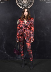 Eleonora Carisi worked a bold-shouldered printed pantsuit at the L'Oreal x Balmain party.