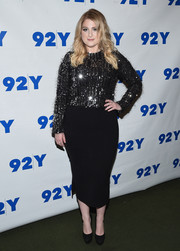 Meghan Trainor teamed her glittery top with a black pencil skirt.