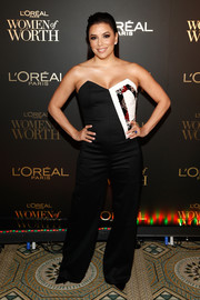 Eva Longoria opted for a strapless monochrome jumpsuit by Genny when she attended the 2018 L'Oréal Paris Women of Worth celebration.