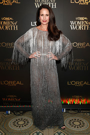 Andie MacDowell went ultra glam in a fringed silver gown by Alberta Ferretti at the L'Oréal Paris Women of Worth celebration.