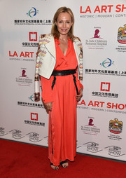 Lubov Azria wore a stunning neon orange jumpsuit to the LA Art Show Opening Night Premiere Party.