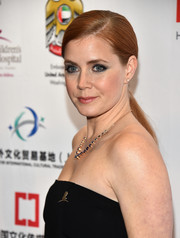 Amy Adams wore her hair swept back into a simple low ponytail for the LA Art Show Opening Night Premiere Party.