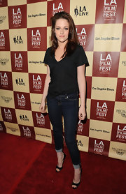 Kristen Stewart rocked a pair of black satin peep toe pumps and skinny jeans at the 2011 LA Film Festival.