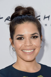 America Ferrera swept her hair up into a voluminous top knot for the LA Film Fest premiere of 'Paint It Black.'