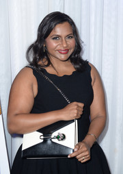 Mindy Kaling went for luxe styling with a bejeweled black-and-white chain-strap bag at the LA Film Festival gala screening of 'The Oath.'