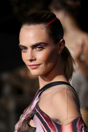 Cara Delevingne styled her hair into a simple ponytail for the LA premiere of 'Carnival Row.'