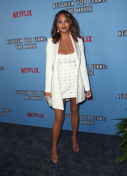 Chrissy Teigen polished off her outfit with a crisp white blazer.