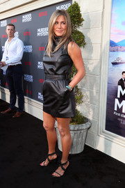 Jennifer Aniston  made an appearance at the LA premiere of 'Murder Mystery' wearing a sleeveless black leather dress by Celine.