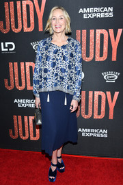 Sharon Stone attended the LA premiere of 'Judy' wearing a loose blue and white print blouse.