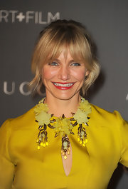 Cameron Diaz channeled the '60s in this bright color and chunky banged updo.