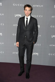 Robert Pattinson looked smoking in his charcoal suit with a subtle satin lapel binding.