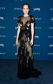 Dakota Johnson looked elegantly theatrical in a feather-embellished mesh-panel gown by Gucci during the LACMA Art + Film Gala.