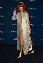 Linda Ramone totally shimmered with her metallic gold hobo bag, boots, coat, and mini dress combo at the LACMA Art + Film Gala.